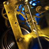 Clock movement. Antique brass clock movement with focus on gears royalty free stock photos
