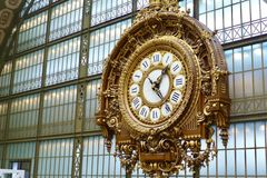 Clock in musee d'Orsay. Musee d'Orsay modern art museum on the bank of the Seine in Paris. An old train station converted into museum Stock Image