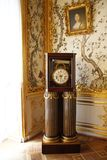 Clock in a museum. Large grandfather clocks exhibited as an exhibit in the Hermitage Museum in St. Petersburg royalty free stock images