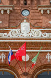 Clock and national flags on the railway station in Kazan. Royalty Free Stock Photos
