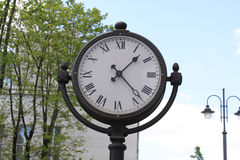 Clock in nature. This is a shot of a classic style clock in nature Royalty Free Stock Image