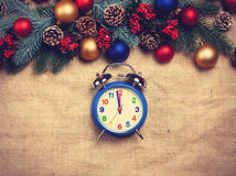 Clock near Pine branches Stock Images