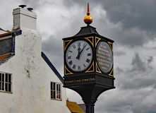 The clock near the sea front at Lyme Regis remembering those who gave their lives in defence of their country royalty free stock photos