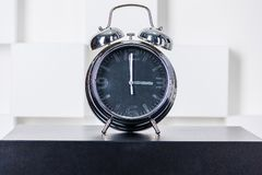 The clock on the nightstand Stock Photography