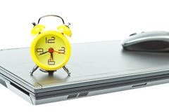 Clock on Notebook as time management Stock Image