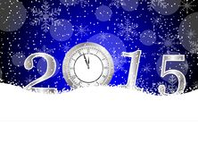 Clock and numbers 2015 on to snow Royalty Free Stock Photography