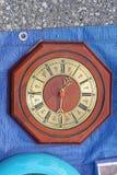Clock. Octagonal wall clock with wood Royalty Free Stock Photo