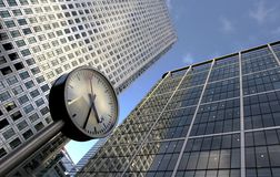 Clock and office buildings Stock Photos