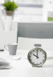 Clock on office desk. Close-up photo of clock on office desk Stock Image