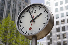 Clock with office windows. In the background Royalty Free Stock Photography