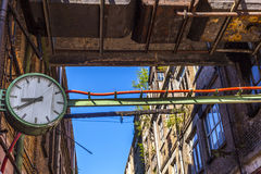 Clock in an old abandoned factory Royalty Free Stock Photo