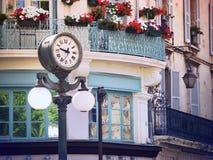 Clock in Old center of Avignon, France. Scene with a historic clock in Old center of Avignon, France, Provence Stock Images
