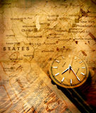 Clock with old map Stock Images