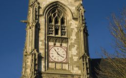 Clock on the old medieval church Saint Leu. Clock on the old french church Saint Leu, Amiens, France Royalty Free Stock Image