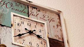 Clock. Old style grungy clock hanging on a wall Stock Photography