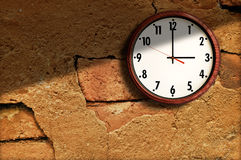 Clock on the old wall cement. Stock Image
