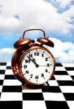 Clock On A Chessboard Royalty Free Stock Image