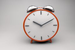 The Clock. Orange 3d Clock With Little Bells in Perspective Stock Images