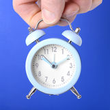 Clock over blue background Stock Images