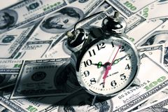 Clock Over Money Stock Photo