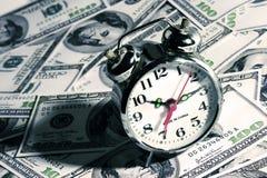 Clock Over Money Stock Photo