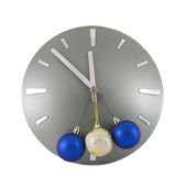 Clock over white with color Christmas balls Royalty Free Stock Photography