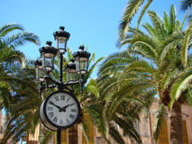 The clock on the palm square Royalty Free Stock Images