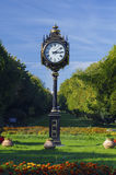 Clock in park. Clock in Herastrau park , Bucharest, Romania royalty free stock images