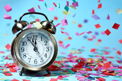 Clock and party decorations Royalty Free Stock Photography