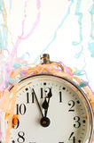 Clock and party streamers Royalty Free Stock Image