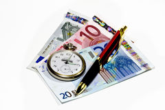 Clock pen and money Stock Images