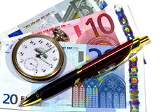 Clock pen and money Royalty Free Stock Image