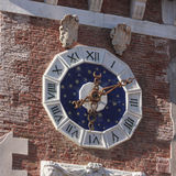 Clock with pendulum and escapement mechanism. Venice military arsenal to understand a concept of culture and tourism Stock Image