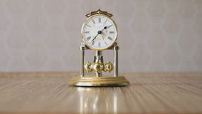 Clock with a pendulum in a form of rotating balls stock video footage
