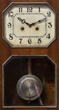 Clock with pendulum. Vintage antique clock with pendulum Royalty Free Stock Photo