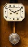 Clock with pendulum. Vintage antique clock with pendulum Stock Image