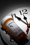 Clock and Pill Bottle Royalty Free Stock Photo