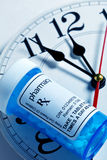 Clock and Pill Bottle Stock Photography