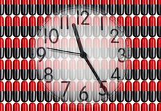 Clock on pills Stock Photography
