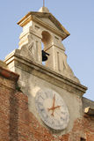 Clock in Pisa. Outdoors clock on an ancient building in Pisa Royalty Free Stock Photo