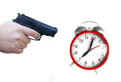 Clock and pistol Royalty Free Stock Photography