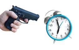 Clock and pistol Stock Photos