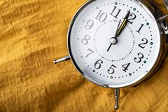 the clock place on the yellow fabric stock image