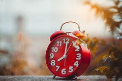 Clock placed on the table. Teaching Ideas Punctuality And focus on time Royalty Free Stock Images