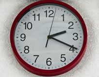 Wall clock round red white plastic. stock photo