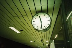Clock at the platform. A clock in platform shows 11.30 night, approching midnight Stock Photo