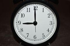 Clock pointing to different times stock images