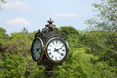 Clock pole in Bucharest Stock Photography
