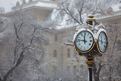 Clock pole. Covered with snow, Bucharest streets Stock Images