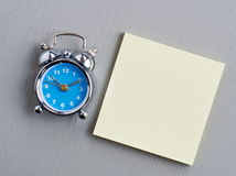 Clock and post-it Stock Photo
